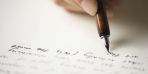 person writing a letter