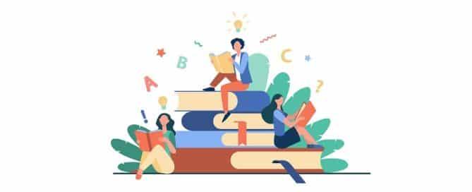 pessoas lenda em uma pilha de livros